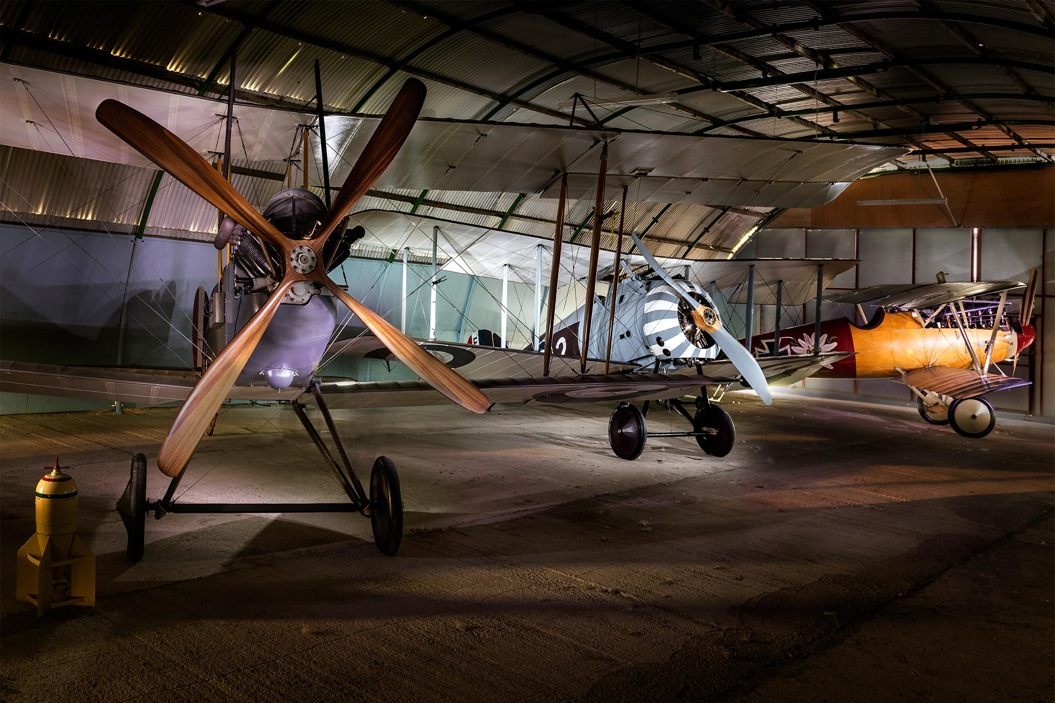 Three replica WW1 aircraft in the Stow Maries hangar