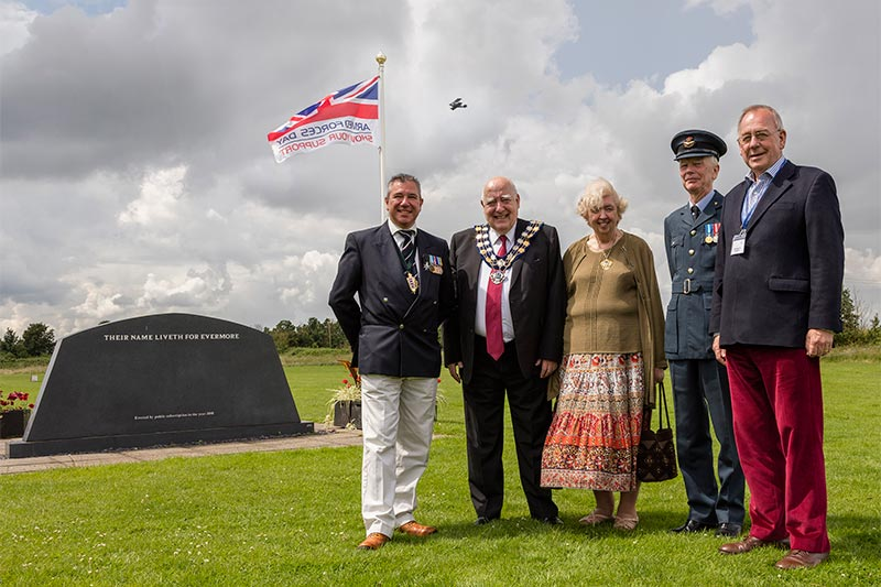 Richard Miller, Peter and Helen Eliott, David Rawlings and Peter Martin commemorating Armed Forces Day in 2016 at Stow Maries Great War Aerodrome in Maldon, Essex
