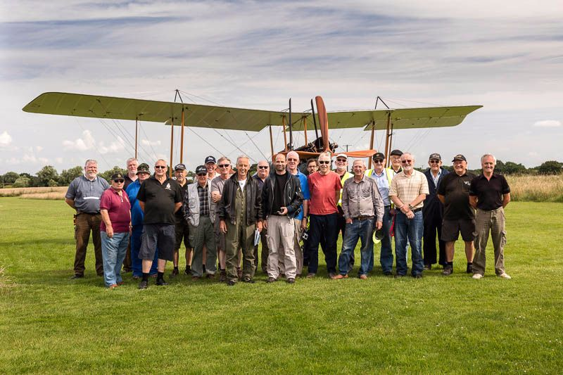 Pilots of the vintage world war 1 replica aircraft aiming to fly to France for the centenary of the commencing of the battle of the Somme - Rob and Jean with volunteers at Stow Maries Great War Aerodrome